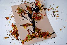 Ink on paper for tree, pieces of dried leaves on tree craft