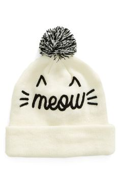 A plush pom tops this purr-fectly stylish beanie made from a soft stretch knit for a chic, meow-rific look.
