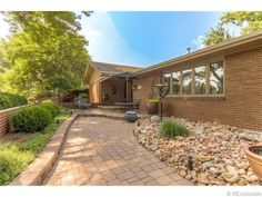 stone front patio / bird feeder - See this home on Redfin! 10680 W 74th Pl, Arvada, CO 80005 #FoundOnRedfin