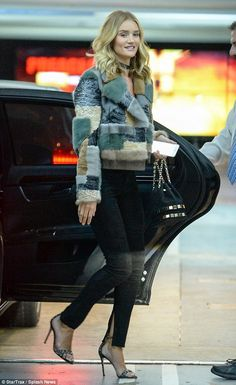 Still smiling: Rosie Huntington-Whiteley couldn't hide her delight on Friday, arriving at ...