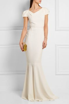 ROLAND MOURET Marilla stretch-crepe gown $3,755 Roland Mouret's white 'Marilla' gown is a stunning choice for evening events or brides. Artfully designed with origami-like panels and elegant capped sleeves, it's made from smoothing stretch-crepe and flares out gently into a feminine fishtail hem. Keep your accessories minimal.