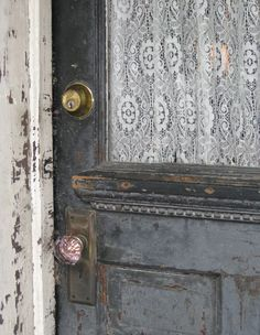 door with lace curtains