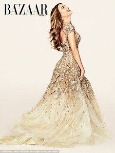 Showstopping! Sofia stunned in a a couture shimmering gold bridal-inspired gown...