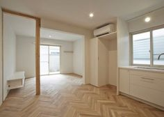 Contemporary exposed elements meets classic design in this renovated Tokyo apartment. The unique installation of the herringbone flooring is a traditional detail in an otherwise modern living space. We appreciate the fact that leaving structural elements exposed is a popular trend among newly renovated Japanese homes.  Kunihiko Matsuba, Seitaro Aso, architecture, interior architecture, interior design, natural wood, white walls, minimalist