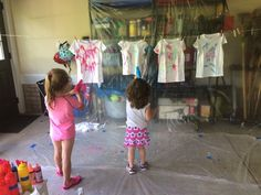 Just bought white tee shirts, squirt guns, and fabric paint. You dilute the paint in water and spray! Totally messy, but so much fun.