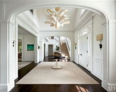 In the entrance hall, the Shelton, Mindel team offset Stern's traditional architecture with a Mauro Fabbro parchment light fixture from Casati Gallery; Foyer Staircase, Entry Hallway, Staircases, Stairs, Architectural Digest, Interior Architecture, Interior And Exterior, Die Hamptons, Plafond Design
