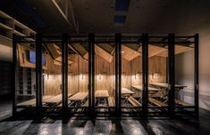 LUO Studio has designed a tiny office in Beijing, with movable desks so that it can be transformed from an office into an amphitheatre-style lecture room. Transformers, Exhibition Room, Timber Slats, Tiny Office, Workplace Design, Strip Lighting, Room Set, Photo Studio, Beijing