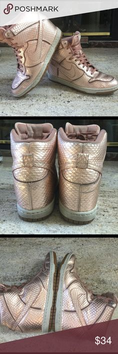🌂🕶NIKE METALIC SWOOSH HEEL SHOES Nike metallic heeled shoes US size 7. They are a coppery pinkish color.please note the shoe lace on the right shoe will need to be replaced Nike Shoes Sneakers