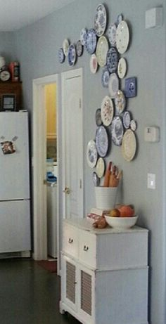 Decorate a wall with hanging plates for a unique, random design. Use your own collectible plates or pick them up at the thrift store for $1 or less! Cool design idea!