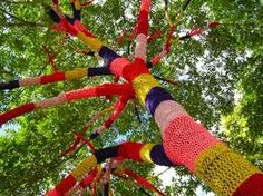 Basically, yarn bombing is legal textile street art.anything) in beautiful works of knitted or crocheted art. Yarn Bombing Trees, Yarn Trees, Crochet Tree, Knit Crochet, Crochet Stitch, Guerilla Knitting, Graffiti, Public Art, Community Art