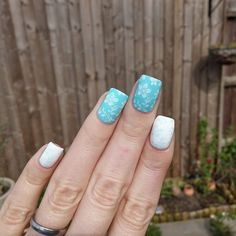 Floral nail art using stamping and Barry M Gellys Cotton & Sky Blue