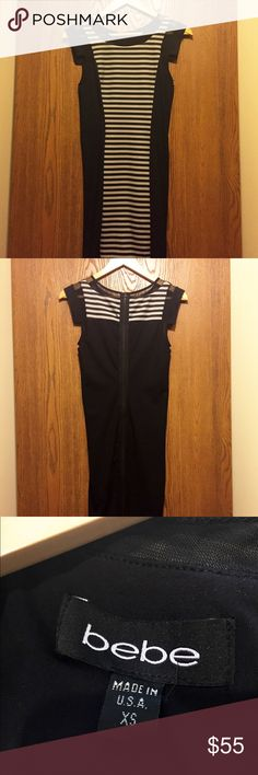Bebe striped dress Black around the outside, white and black stripes in the middle, the white stripes have black mesh over it. bebe Dresses