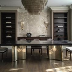 Huge brass table bases with custom tabletop by @tankcalgary. Vintage smoky chandelier | Canadian interior designer Nam Dang Mitchell