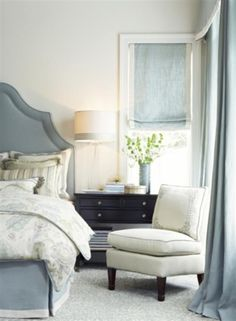 Draperies/bedding in fabric Slubby Linen in the color Ocean Custom Duvet in the fabric Slubby Linen in the color Cream with decorative trim.