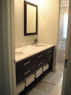 dark cabinetry with marble surface, hexagonal floor tile, subway tile on bath tub