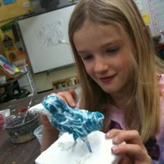 Aluminum foil and paper mache. Great project to do along with animal adaptation unit.