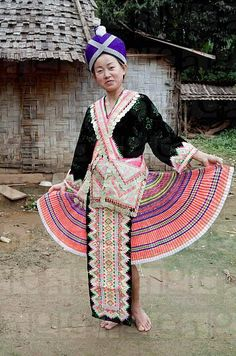 Laos | Girl showing off her traditional Hmong clothes, near the village Vang Vieng | © Digitalpress