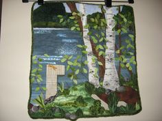 """""""The Lake"""" By JB.  Applique,thread painted, fabric painted;used netting overlay, Angelina for water. Inspiration Pam Holland,Wendy Butler Burns"""