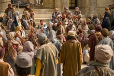 The young Jesus teaches in the temple.