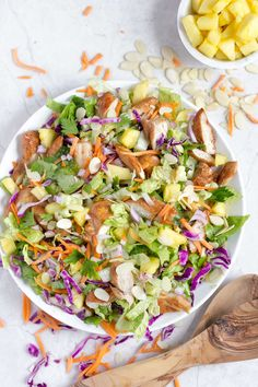 This healthy, Hawaiian salad with pineapple chicken has pineapple chunks, romaine, red cabbage, carrots, almonds, and a soy sauce and sesame vinaigrette!