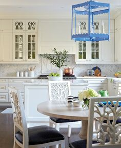 pretty white traditional kitchen and breakfast area with bold french blue and apple green accents.