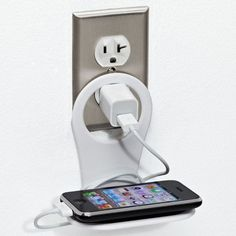 This ingenious little smartphone holder that organizes USB cords and cradles your precious device like a newborn baby bunny. Smartphone Holder, Cell Phone Holder, Container Store, Phone Charger, Phone Stand, Charger Holder, Apartment Needs, Apartment Hacks, Ideas