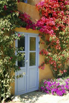 Festive florals pair just fabulously with the dreamy blue door.