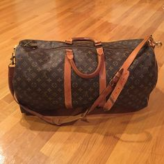 Louis Vuitton Keepall Bandouliere 55 (no trades) Guaranteed authentic. Pantina on the middle handles and long strap. Sides do not show pantina because the leather was replaced by LV. Inside is completely clean. Some wear on the lock and zipper pulls. Sold as is. All sales are final. Louis Vuitton Bags