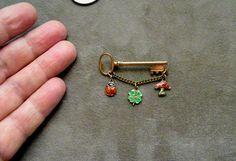 Antique German enamel & Silver Lucky Charm Brooch w Ladybug Clover & Mushroom        Enlarge    Sell one like this    Antique German enamel & Silver Lucky Charm Brooch w Ladybug Clover & Mushroom