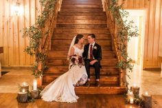 Wedding staircase decor. LOVE the greenery all the way up and the candles at the bottom.