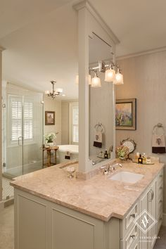 Amy Vermillion Interiors- Historic Charleston Home...love the center mirror and double vanities designed like this when space is limited for side by side vanities!