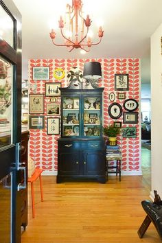 Coral/orange Orla Kiely + black accents = Perfection. Thomas & Tara's Eclectic Collected Home in Nashville