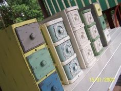 Old sewing machine drawers - do not like the paint but like the grouping