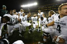 Michigan State players look to pray near midfield after they defeated Michigan 27-23 in the final seconds of their Big Ten game at Michigan Stadium in Ann Arbor Saturday, October 17, 2015. (Mike Mulholland   MLive.com)