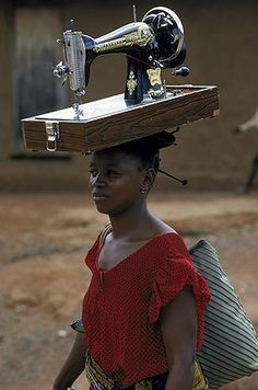 Africa | Woman with a sewing machine in Zaire | ©Jose Azel
