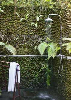 Outdoor, Natural Stone Fence With Moss Feat Modern Outdoor Shower Ideas Plus Wooden Standing Towel Stand ~ Extraordinary Outdoor Shower Ideas to Give You More Refreshing Bathing Experience