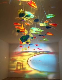 Plexiflex model aeroplanes and light projector.  By Rashad Alakbarov.  In the exhibit, FLY TO BAKU - Contemporary Art from Azerbaijan