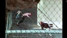 Stacy Peralta 1970s skateboarding Los Angeles school yard asphalt screen shot from documentary Dogtown and Z-Boys (2001)