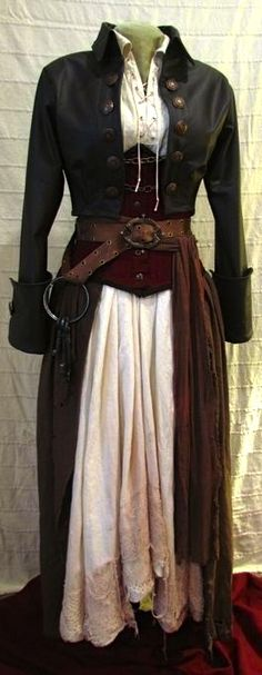 Pirate. Poet's shirt. Underbust corset. Skirt. Jacket with long tails and cuffed sleeves. Belt. (halloween costume)