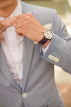 Peach color linen bow tie paired with stone gray jacket. Perfect summer style for dapper grooms and groomsmen