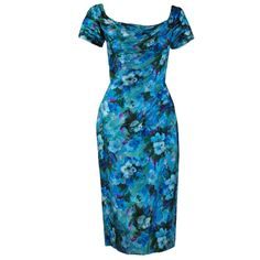 1950's Ceil Chapman Watercolor Blue Floral Ruched Print-Silk Cocktail Dress | From a collection of rare vintage evening dresses at http://www.1stdibs.com/fashion/clothing/evening-dresses/