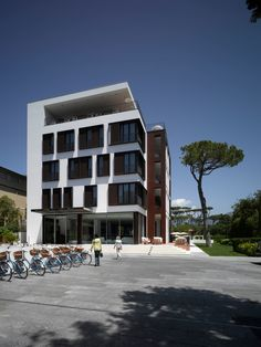 Hotels & Resort, Astonishing Five Star Hotel Principe Forte Dei Marmi In Italy Featuring Architecture Design With White Wall Exterior, Large Concrete Courtyard And Plant: Amazing Modern Hotel Design with the Picturesque View of Apuane Alps