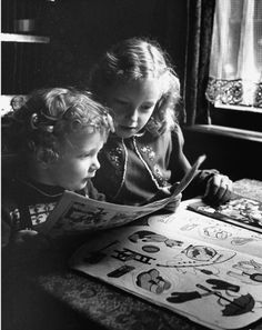 Two little girls reading comics, 1953