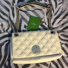 Kate Spade Quilted Purse Like new! Worn once, spotless interior and no scratches on logo.  Straps can be doubled as shown or worn longer. Guaranteed authentic. Cream with silver metal. kate spade Bags Shoulder Bags