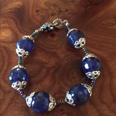 Beautiful handmade bracelet. Blue and silver. Amazing detail. Fabulous heart shaped clasp. Gorgeous blue beads with silver scroll detail. Handmade by a friend. Exquisite and unique. One of a kind. Homemade Jewelry Bracelets