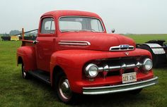 '52 Ford red pickup \ I would love to own one of these some day!!