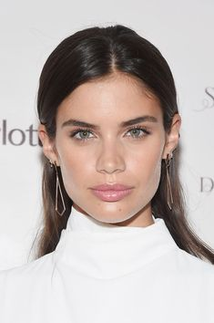 Sara Sampaio Long Straight Cut - Sara Sampaio wore her hair down with the sides tucked behind her ears when she attended the Charlotte Tilbury x Samsung event.