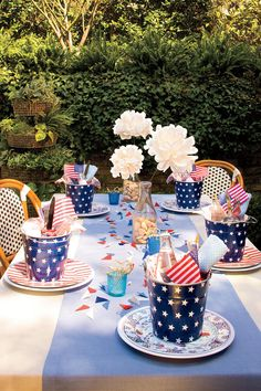 Table Setting - An All-American Table Setting - Southernliving. During summer in the South, life just slows down and gets more laid-back. And so does the entertaining. No matter what elements you choose to include, the key to a fun, casual party is in the no-fuss details. Steal these simple decorating ideas to create a setting that doesn't look simple at all. From playful individual party pails to personalized drinking straws that also serve as place cards, set your table American style.