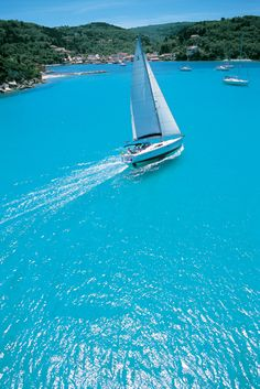 GREECE CHANNEL | Our Beneteau 50 'Kassandra' cruising into Lakka Bay at the top of Paxos...