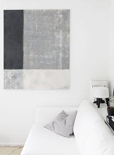 white walls + white sofa + geometric painting